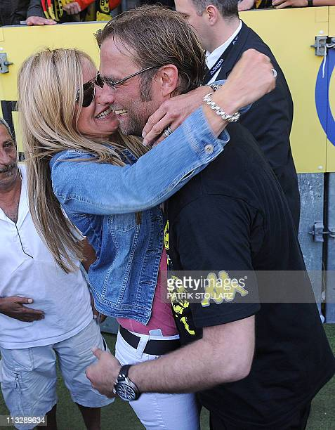 Dortmund's head coach Juergen Klopp hugs his wife Ulla after the German first division Bundesliga football match Borussia Dortmund vs 1FC Nuremberg...