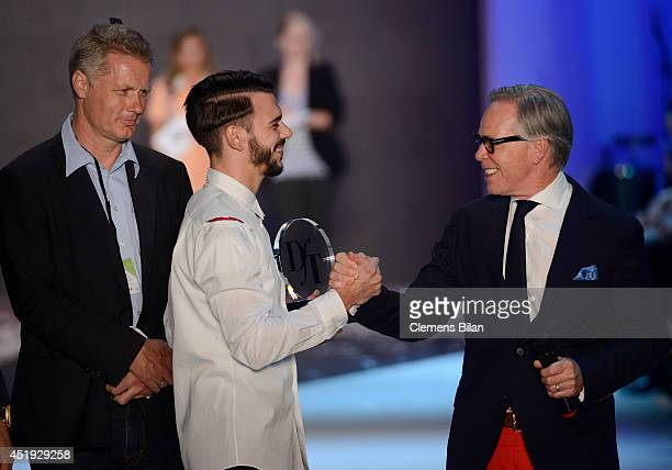 DfT Winner 2014 Matteo Lamandini and Tommy Hilfiger seen on the runway during the DfT Award by Peek Cloppenburg Duesseldorf and Fashion ID as part of...