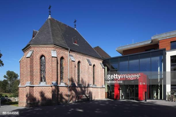 DGrevenbroich Erft Lower Rhine Rhineland North RhineWestphalia NRW DGrevenbroichWevelinghoven brick chapel St Joseph and main entrance of the...