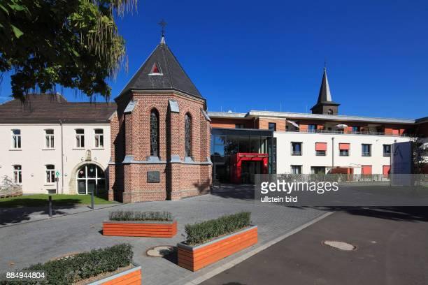 DGrevenbroich Erft Lower Rhine Rhineland North RhineWestphalia NRW DGrevenbroichWevelinghoven building complex fltr catholic rectory St Joseph Chapel...