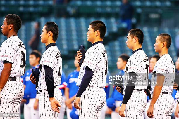 Dh Kotaro Kiyomiya of Japan lines up for national anthem the game between Australia and Japan in the super round game between Japan v South Korea...