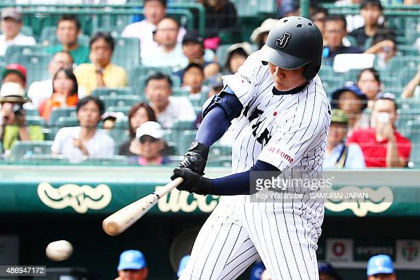 Dh Kotaro Kiyomiya hits a single in the bottom half of the third inning in the super round game between Japan v Cuba during the 2015 WBSC U18...