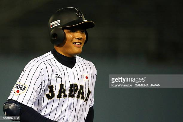 Dh Kotaro Kiyomiya looks on in the bottom half of the third inning in the first round game between Japan and Brazil during the 2015 WBSC U18 Baseball...