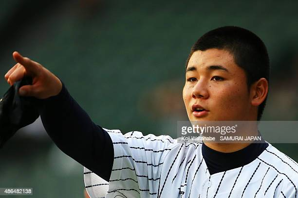 Dh Kotaro Kiyomiya of Japan looks on the game between Australia and Japan in the super round game between Japan v South Korea during the 2015 WBSC...