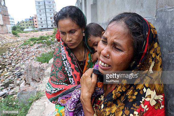 Dhaka 22 April 2015 Two women visit the site of the Rana Plaza building ruins in search of a lost loved one Thousands of mourners commemorated the...
