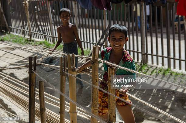 Dhaka, Bangladesh. 9 July 2013. According to the Labour Law of Bangladesh 2006, the minimum legal age for employment is 14. However, as 93 per cent...