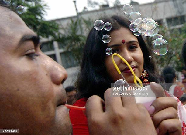 A vendor makes bubbles during the celebration of 'Pohela Baishakh' the first day of the Bengali New Year at Ramna Batomul in Dhaka 14 April 2007 The...