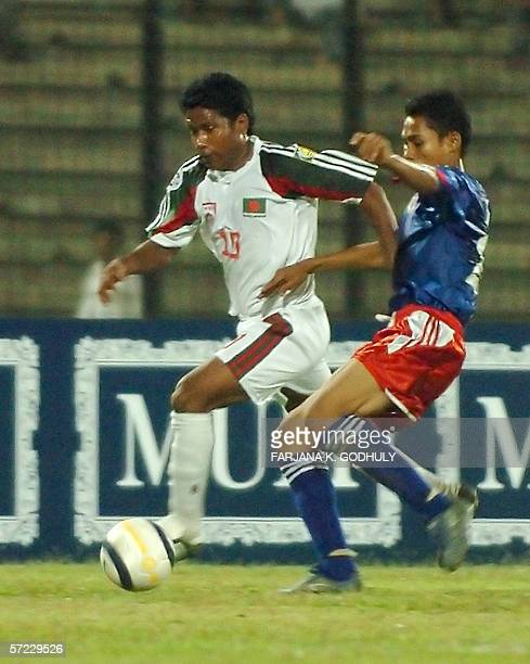 Bangladesh footballer Ahmed Alfaz dribbles the ball past Cambodian opponent Tiny Tieng during a match in the Asian Football Confederation Challenge...
