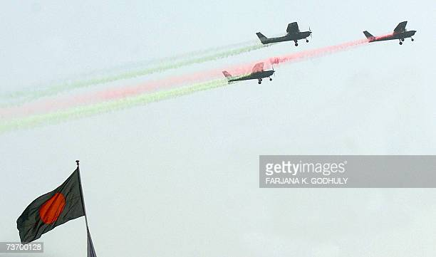 Bangladeshi aircraft release colours of the national flag during a military parade to mark the country's 37th Independance Day in Dhaka 26 March 2007...