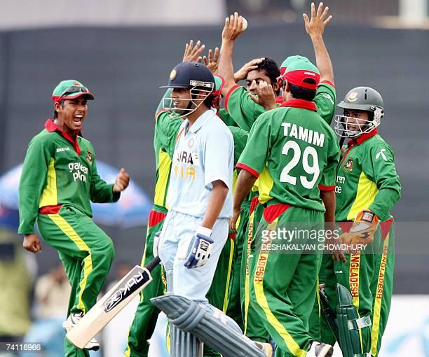 Bangladeshi cricketers celebrate the dismissal of Indian batsman Gautam Gambhir during the first One Day International Match between India and...