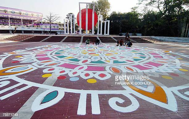 Bangladeshi fine arts students paint a design on the ground in front of the Shahid Minar in Dhaka 20 February 2007 as part of preparations for the...