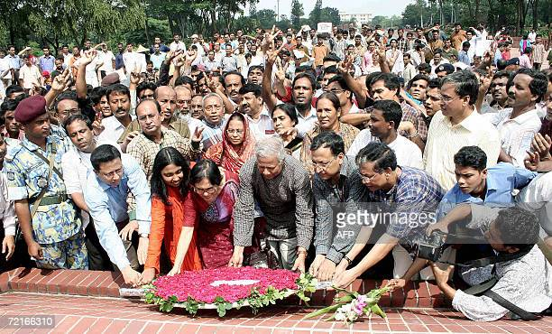 Bangladeshi Nobel Peace Prize winner Muhammad Yunus is accompanied by family and supporters as he lays a wreath at The National Monument in Savar, on...