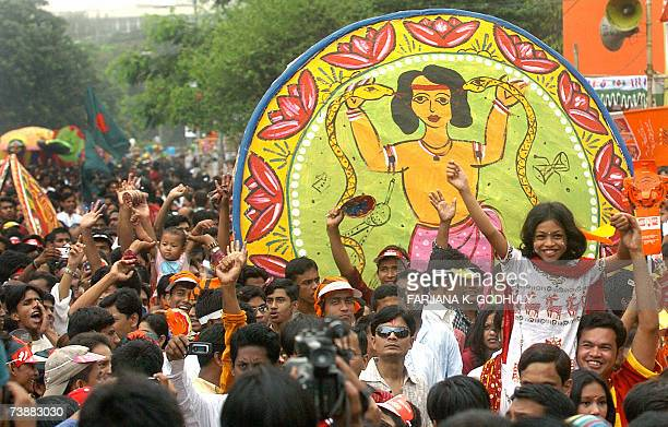 Bangladeshi people cheer as they take part in a colorful rally during the celebration of 'Pohela Baishakh' the first day of the Bengali New Year at...