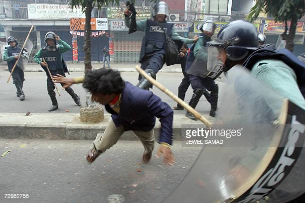 Bangladeshi police beat an unidentified man during clashes with activists of a 14party opposition alliance on the third day of the threedaylong...