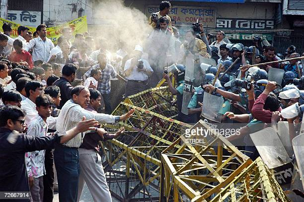 Bangladeshi policemen clash with activists of the Jubo Sangram Parishad under the banner of the main opposition party Awami League during a...