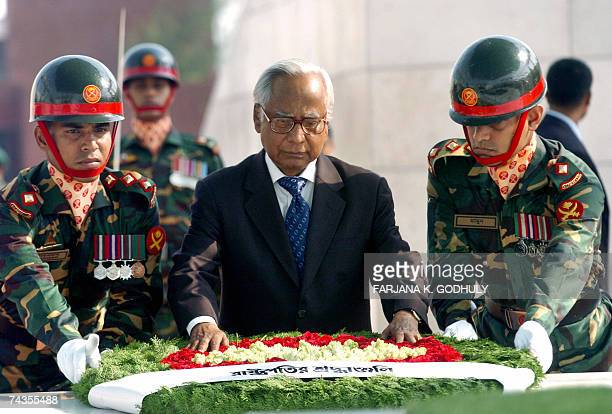 Bangladeshi President Iajuddin Ahmed is assisted by soldiers as he lays a floral wreath while paying his respects during a ceremony to mark the death...