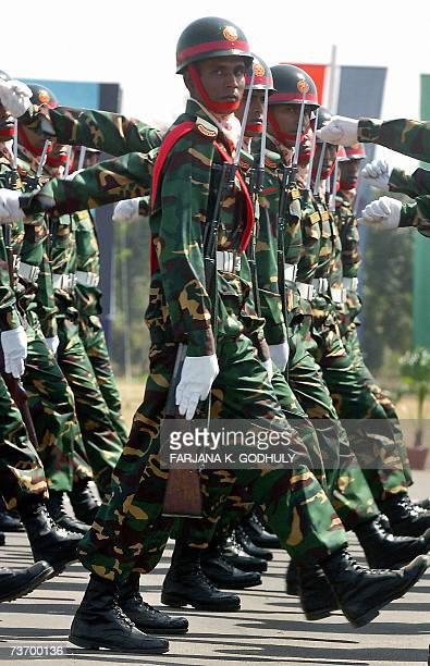 Bangladeshi soldiers march past during a military parade to mark the country's 37th Independance Day in Dhaka 26 March 2007 Bangladesh became...