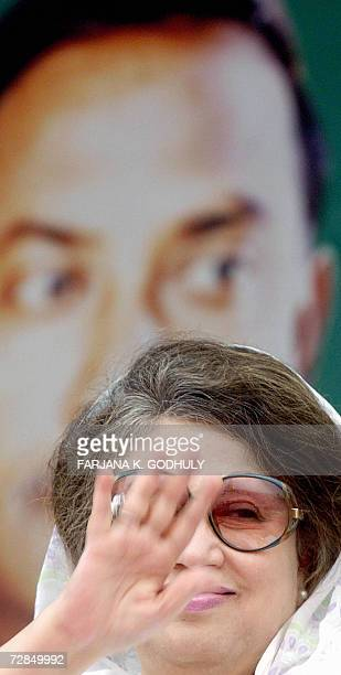 Former Bangladeshi Prime Minister and leader of the Bangladesh Nationalist Party Khaleda Zia waves to supporters and activists while sitting in front...
