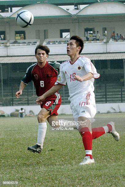 Hong Kong player Chan yiu lun vies for the ball with Bangladesh's Al Mamun during the AFC Asian Cup qualifying round match at the Bangabandhu...