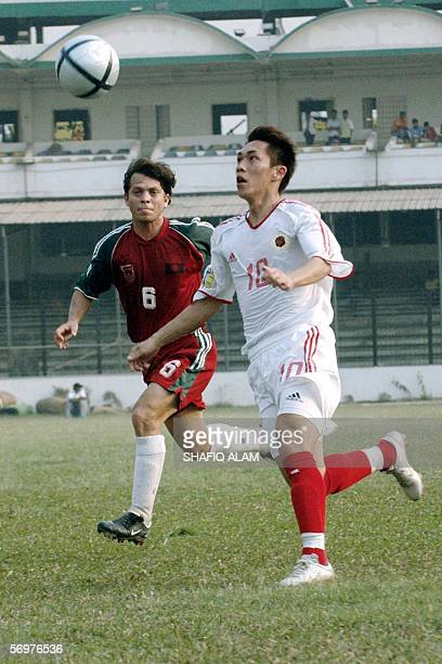 Hong Kong player Chan Yiu Lun vies for the ball with Bangladesh's Al Mamun during their AFC Asian Cup qualifying round match at the Bangabandhu...