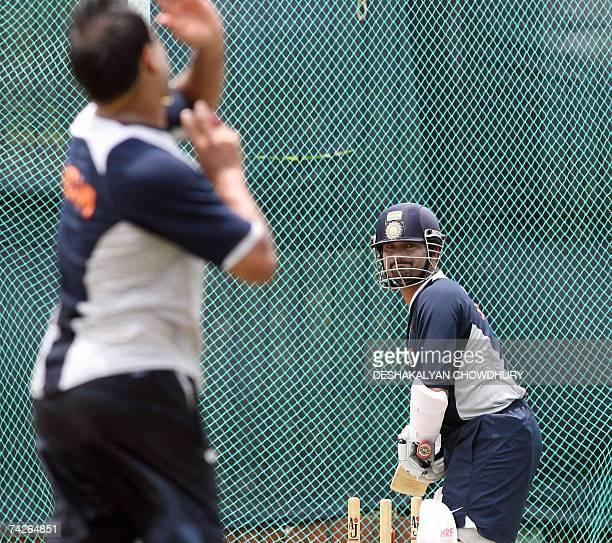 Indian cricketer Sachin Tendulkar prepares to bat as fielding coach Robin Singh bowls to him during a net practice session at the ShereBangla...