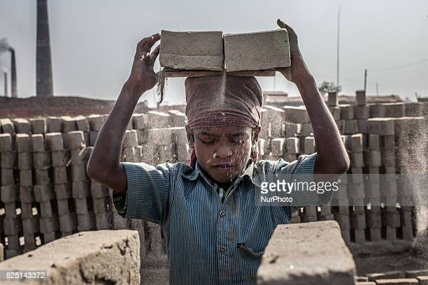 Dhaka Bangladesh Jashim works in a brickfield He earns 1USD per day for carrying bricks The world is going through a speedy urbanization and...