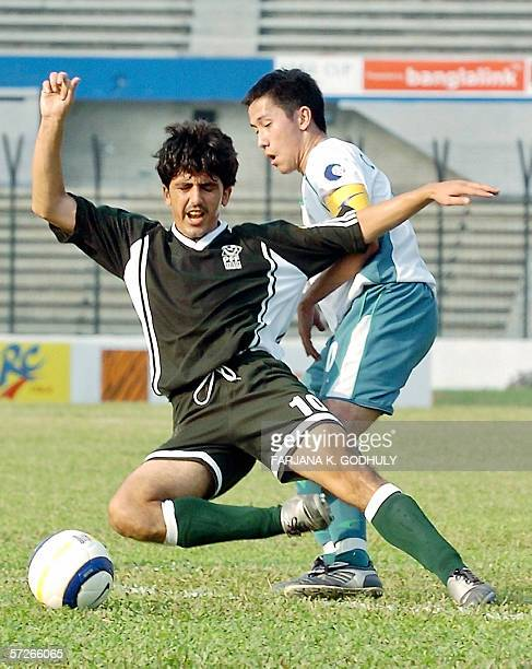Pakistanfootball player Essa Muhammad fights for a ball with Macau opponent Lam Ka Pou during a match between Pakistan and Macau in the Asian...