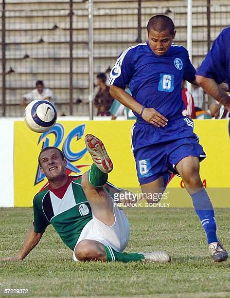 Palestinian footballer Alkord Ziyad vies for the ball with Guam opponent Ricfrancis Mantanona during a match between Palestine and Guam in the Asian...