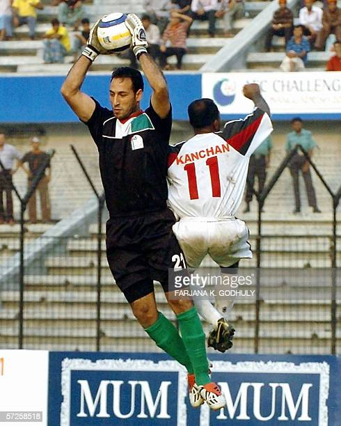 Palestinian goalkeeper Ramzi Saleh successfully stops attack of Bangladesh's Mohamme Rokon during a match between Bangladesh and Palestine in the...