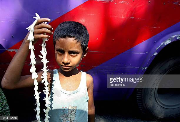 Rubel a sevenyear old street child sells flower garlands at an intersection of a busy road in Dhaka 06 November 2006 Although child labour is banned...