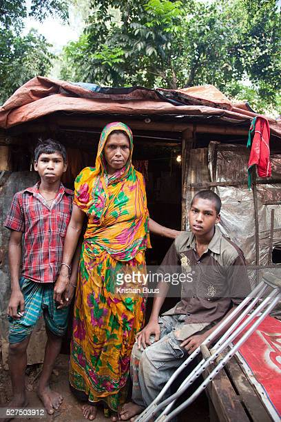 Dhaka Bangladesh Sjojun 14 years old lost the use of his legs due to polio and CSID provides him with crutches He lives with his mother and brother...