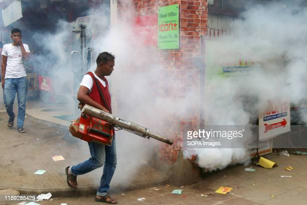Dhaka City Corporation worker fumigates the area to kill mosquitoes during a Campaign in Dhaka Dhaka City Corporation arranged an antidengue campaign...