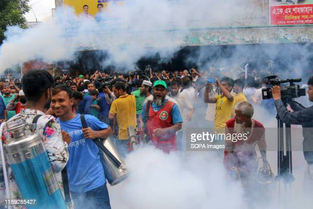 Dhaka City Corporation workers and people gather during a Campaign in Dhaka Dhaka City Corporation arranged an antidengue campaign to raise awareness...