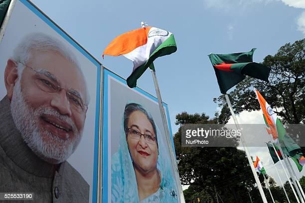 Dhaka is ready to welcome Indian Prime Minster Norendra Modi portraits of Bangladesh Prime Minister Sheikh Hasina and her Indian counterpart Narendra...