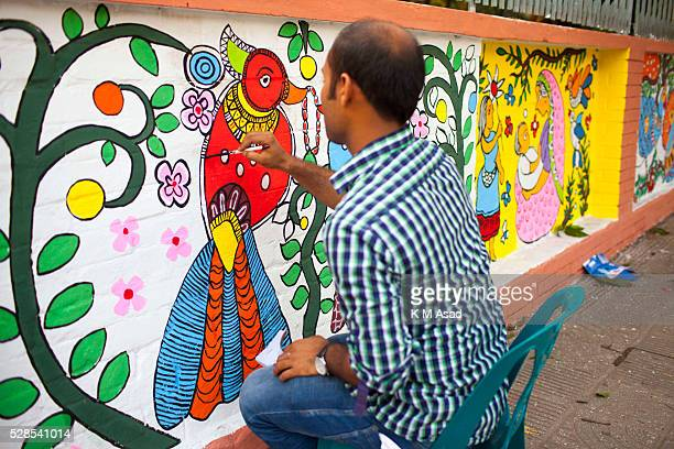 CHARUKOLA DHAKA DHAKA BANGLADESH Dhaka University Art Institute student paint the all area wall In front of art institute building for colorful...
