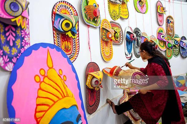 CHARUKOLA DHAKA DHAKA BANGLADESH Dhaka University Art Institute student paints masks for colorful preparation to celebrate upcoming Bengali New Year...