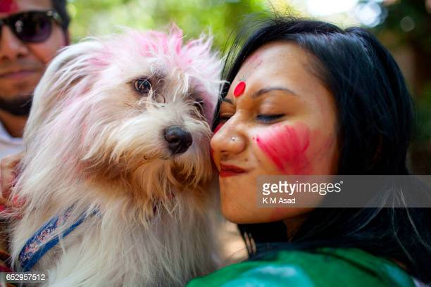 UNIVERCITY DHAKA BANGLADESH Dhaka University fine Art Student with dog celebrate the Holi Festival or Festival of Colors after smearing each other...