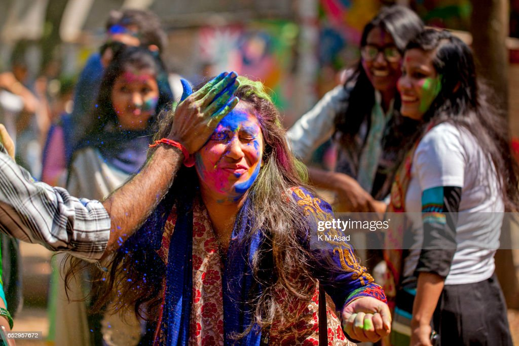UNIVERCITY, DHAKA, BANGLADESH - : Dhaka University fine Art Students celebrate the Holi Festival or Festival of Colors after smearing each other with colored powder in Dhaka, Bangladesh. Holi festival is celebrated on the full moon day in the month of Phalguna and marks the start of the spring season.
