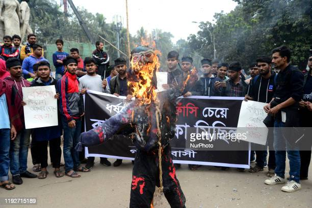 Dhaka University students set fire to the effigy of a rapist demand to hang the rapist of the rape case of a female student of the university in...
