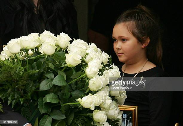 Dhakota Williams daughter of Carl Williams watches as her fathers coffin is carried away during the funeral of convicted drug trafficker and murderer...