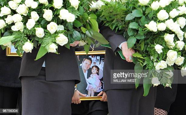 Dhakota Williams , daughter of slain gangland killer Carl Williams, carries a photo of her and her father as she leaves his funeral service, in...