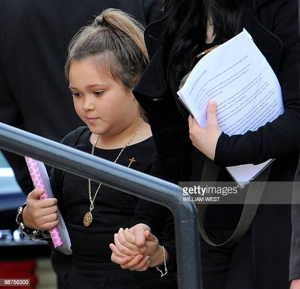 Dhakota Williams , daughter of slain gangland killer Carl Williams, is escorted into church for his funeral service, in Melbourne on April 30, 2010....