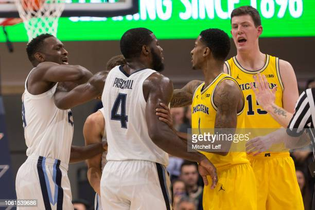 Dhamir CosbyRoundtree Collin Gillespie Eric Paschall of the Villanova Wildcats gets into an altercation with Charles Matthews and Jon Teske of the...