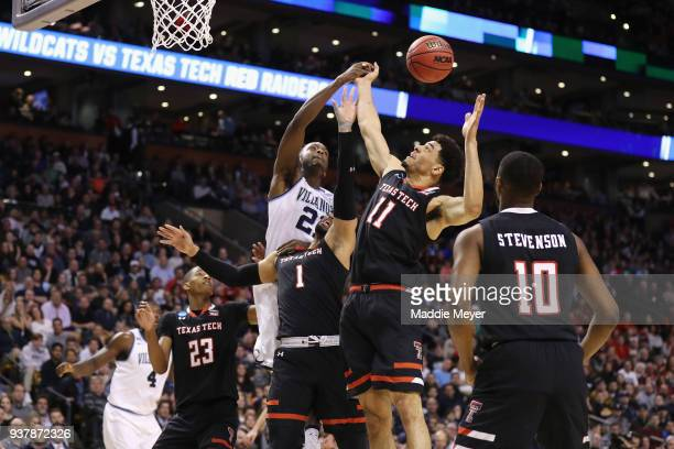 Dhamir CosbyRoundtree of the Villanova Wildcats battles for the ball with Brandone Francis and Zach Smith of the Texas Tech Red Raiders during the...