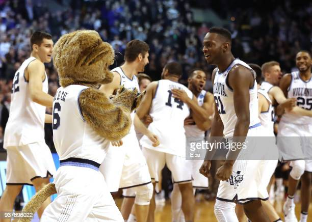 Dhamir CosbyRoundtree of the Villanova Wildcats celebrates with the mascot after defeating the Texas Tech Red Raiders 7159 in the 2018 NCAA Men's...