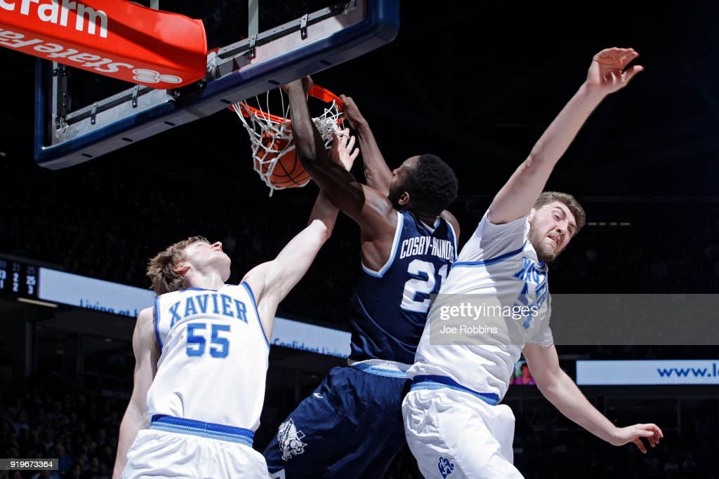 Dhamir Cosby-Roundtree #21 of the Villanova Wildcats dunks against J.P. Macura #55 and Sean O'Mara #54 of the Xavier Musketeers in the second half of a game at Cintas Center on February 17, 2018 in Cincinnati, Ohio. Villanova won 95-79.