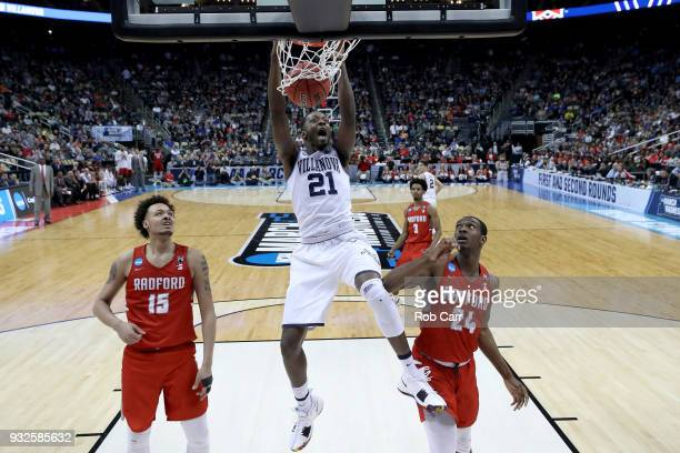 Dhamir CosbyRoundtree of the Villanova Wildcats dunks the ball against the Radford Highlanders during the second half of the game in the first round...