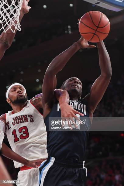 Dhamir CosbyRoundtree of the Villanova Wildcats gets fouled by Marvin Clark II of the St John's Red Storm during an NCAA men's basketball game at...