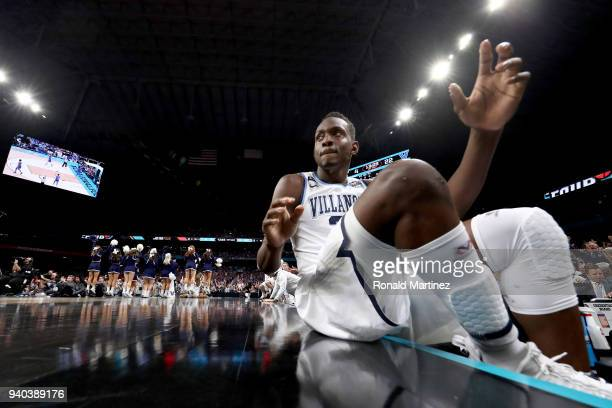 Dhamir CosbyRoundtree of the Villanova Wildcats looks on from the bench in the first half against the Kansas Jayhawks during the 2018 NCAA Men's...
