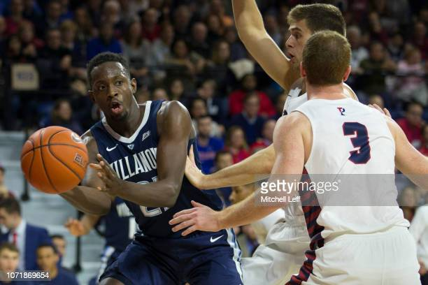 Dhamir CosbyRoundtree of the Villanova Wildcats passes the ball against Jake Silpe of the Pennsylvania Quakers in the first half at The Palestra on...